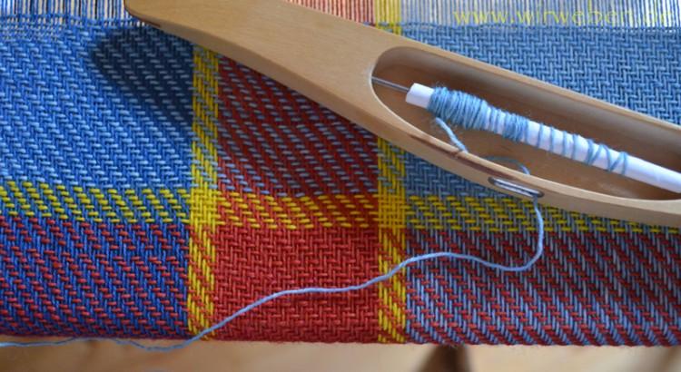 Tuch auf Webstuhl
